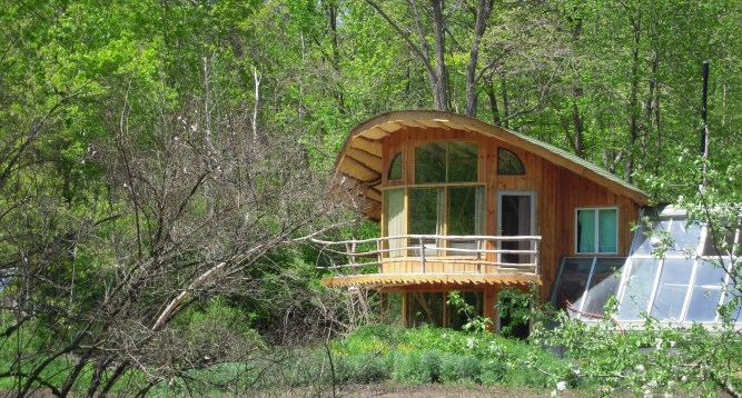 the bookend house at driftless farm and attached greenhouse